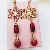 Vintage red and black glass and brass filigree earrings.