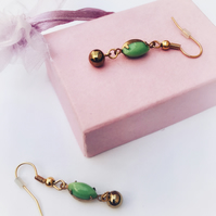 Vintage pea green earrings.