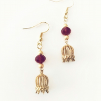 Ruby red faceted dangly glass earrings with golden beads and birdcage