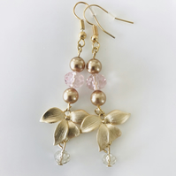 Pink glass and golden flower dangle earrings