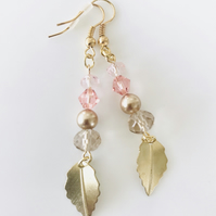 Pale pink and gold earrings with golden leaves