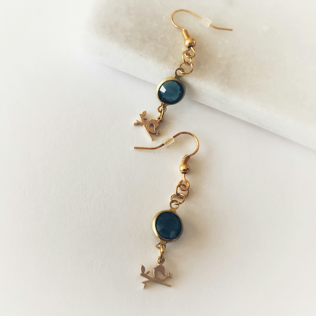Blue glass gem bird dangle earrings