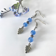 FREE P&P Cornflower blue glass dangle earrings with brass leaves