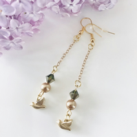 Dangle gold and green bead earrings with dove charms