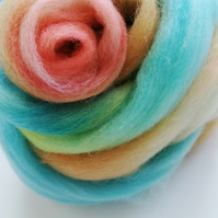 Hand dyed roving , 52grams. Over the Shore colourway