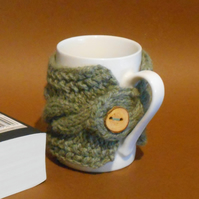 Mug cosy handknit green pure British wool with handmade wooden button.
