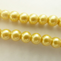 100 gold glass pearls