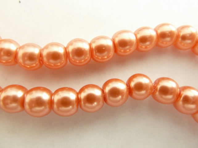 100 peach glass pearls