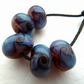 handmade lampwork glass beads, purple waves