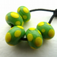 handmade lampwork glass beads, green and yellow spots
