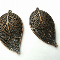 2 copper leaf pendants