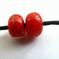 handmade lampwork glass beads, red and gold swirl pair