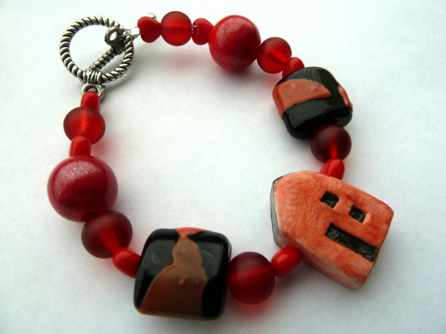 ceramic and lampwork red house bracelet
