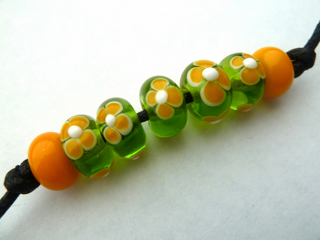 green and yellow flower beads