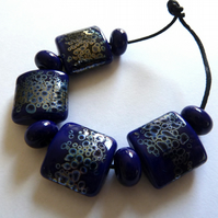 blue and silver lampwork beads