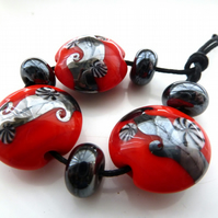 red and grey lampwork glass beads