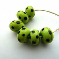 green and black lampwork beads
