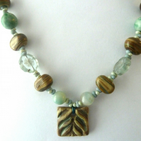cream ceramic and lampwork necklace