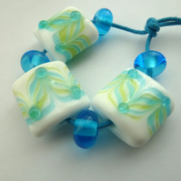blue and green stripes handmade lampwork glass beads