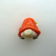 red gnome handmade lampwork glass bead