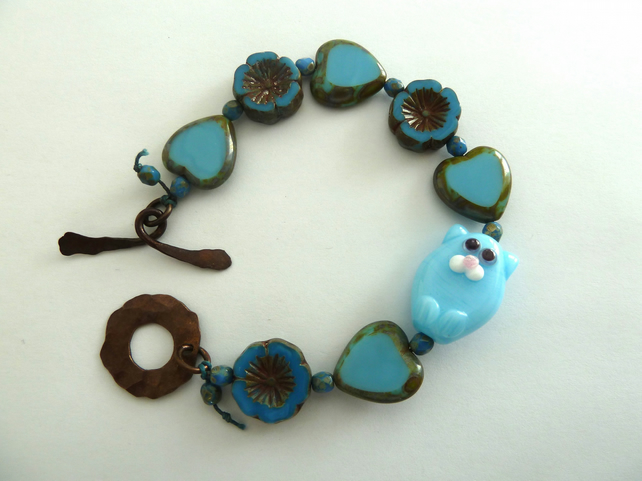 blue cat lampwork glass and copper bracelet