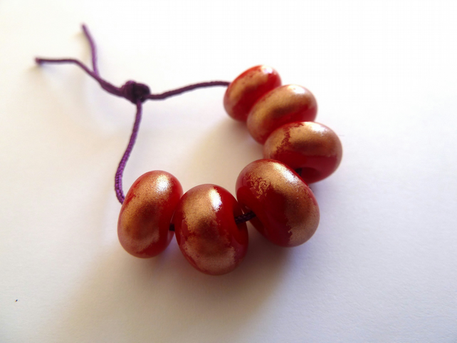 red and bronze dust handmade lampwork glass beads