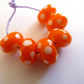 orange and white spot lampwork beads