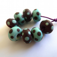 red and blue spotty lampwork glass beads