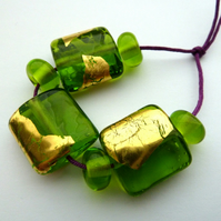 green and gold leaf lampwork beads