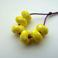 yellow and white spot lampwork glass beads