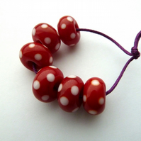 red spotty lampwork glass beads
