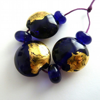 blue and gold leaf lampwork beads