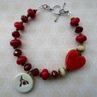 robin lampwork and ceramic bracelet