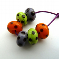 orange, purple and green spotty lampwork beads