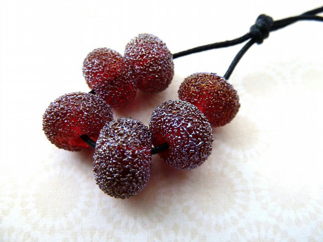 red star dust lampwork glass beads