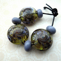 purple and green lampwork glass beads