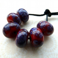 red and purple handmade lampwork glass beads