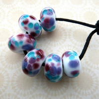 purple and blue lampwork glass beads