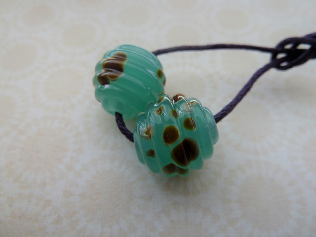 handmade lampwork glass beads, green raku ribbed pair