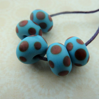 blue and red spots handmade lampwork glass beads