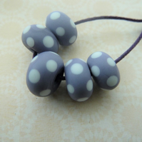 handmade lampwork purple and white spot beads