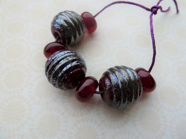 red and silver lampwork glass beads