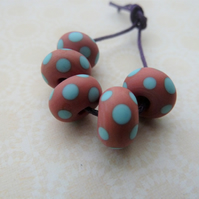 coral and blue spot lampwork glass beads