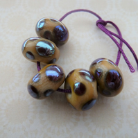 handmade lampwork glass beads, ivory and silver spots