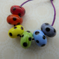 handmade lampwork rainbow glass beads with black spots set