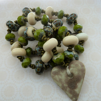 handmade lampwork and ceramic cream heart necklace