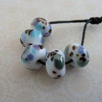handmade lampwork glass beads purple frit set
