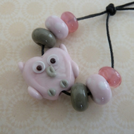 handmade pink owl glass bead set
