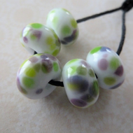 green and purple frit lampwork glass beads