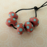 handmade lampwork glass beads, coral and blue spots